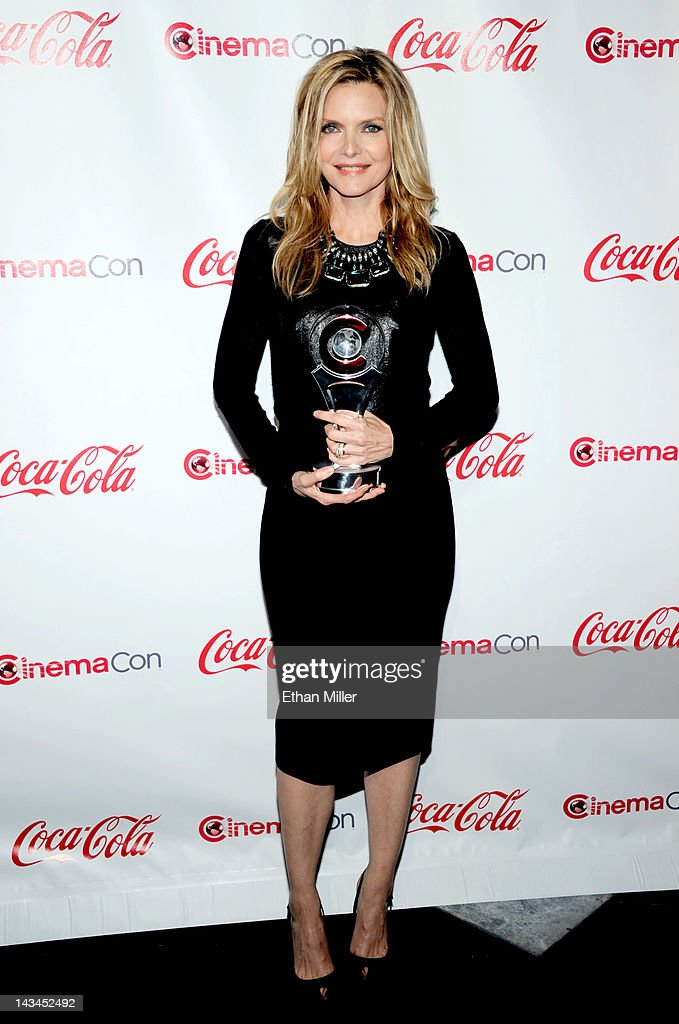 Actress <a gi-track='captionPersonalityLinkClicked' href=/galleries/search?phrase=Michelle+Pfeiffer&family=editorial&specificpeople=212951 ng-click='$event.stopPropagation()'>Michelle Pfeiffer</a>, recipient of the Cinema Icon Award, arrives at the CinemaCon awards ceremony at Pure Nightclub at Caesars Palace on April 26, 2012 in Las Vegas, Nevada. CinemaCon is the official convention of the National Association of Theatre Owners.