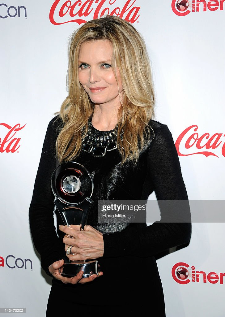 Actress <a gi-track='captionPersonalityLinkClicked' href=/galleries/search?phrase=Michelle+Pfeiffer&family=editorial&specificpeople=212951 ng-click='$event.stopPropagation()'>Michelle Pfeiffer</a>, recipient of the Cinema Icon Award, arrives at the CinemaCon awards ceremony at the Pure Nightclub at Caesars Palace during CinemaCon, the official convention of the National Association of Theatre Owners April 26, 2012 in Las Vegas, Nevada.