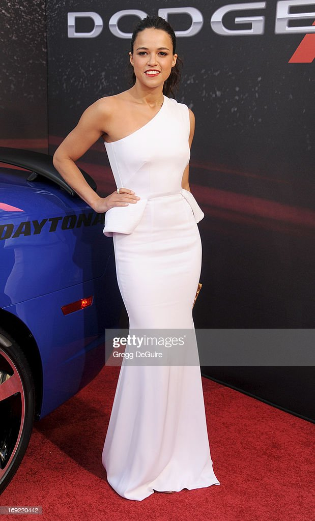 Actress Michelle Rodr'guez arrives at the Los Angeles premiere of 'Fast & The Furious 6' at Gibson Amphitheatre on May 21, 2013 in Universal City, California.