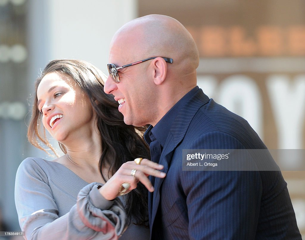 Actress Michelle Rodriguez and actor Vin Diesel attend the Star Ceremony for Vin Diesel on the Hollywood Walk Of Fame held on August 26, 2013 in Hollywood, California.