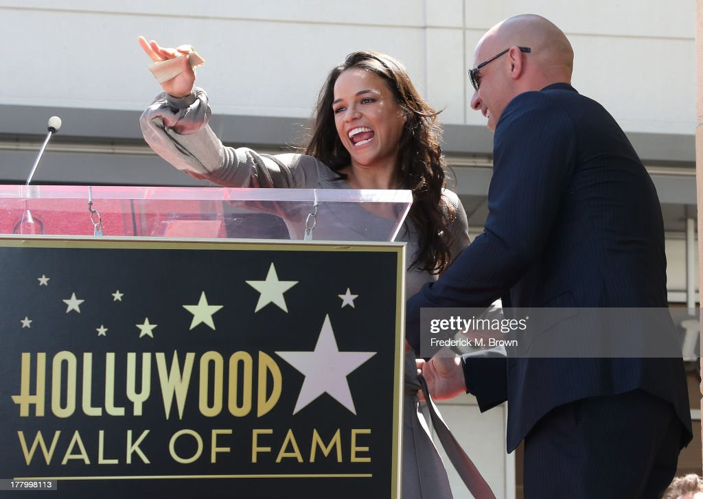 Actress Michelle Rodriguez (L) and actor Vin Diesel during the ceremony honoring actor Vin Diesel on The Hollywood Walk of Fame on August 26, 2013 in Hollywood, California.