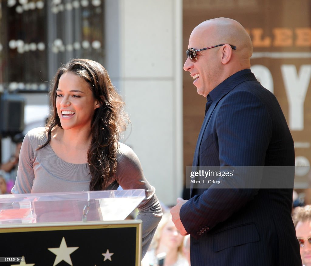 Actress Michelle Rodriguez and actor Vin Diesel participate in the Star Ceremony for Vin Diesel on the Hollywood Walk Of Fame held on August 26, 2013 in Hollywood, California.