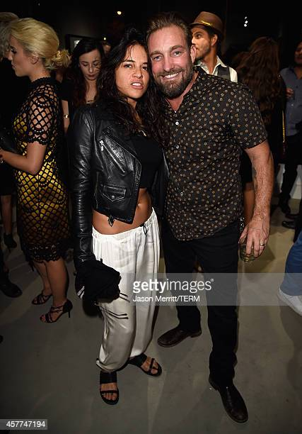 Actress Michelle Rodriguez and photographer Brian Bowen Smith attend the Brian Bowen Smith WILDLIFE show hosted by Casamigos Tequila at De Re Gallery...