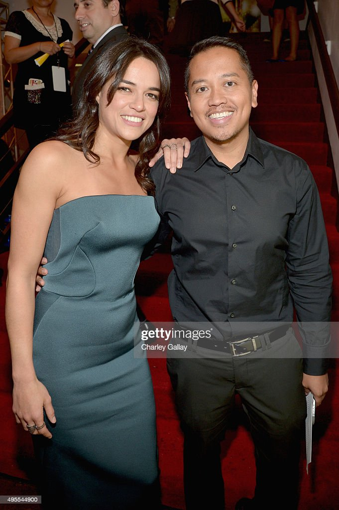 Actress <a gi-track='captionPersonalityLinkClicked' href=/galleries/search?phrase=Michelle+Rodriguez&family=editorial&specificpeople=206182 ng-click='$event.stopPropagation()'>Michelle Rodriguez</a> (L) and PR executive <a gi-track='captionPersonalityLinkClicked' href=/galleries/search?phrase=Rembrandt+Flores&family=editorial&specificpeople=693163 ng-click='$event.stopPropagation()'>Rembrandt Flores</a> attend the 11th Annual Chinese American Film Festival Opening Ceremony at The Montalban Theatre on November 3, 2015 in Hollywood, California.