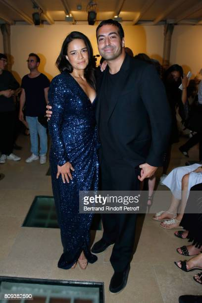 Actress Michelle Rodriguez and producer Mohammed Al Turki attend the Azzedine Alaia Fashion Show as part of Haute Couture Paris Fashion Week Held at...