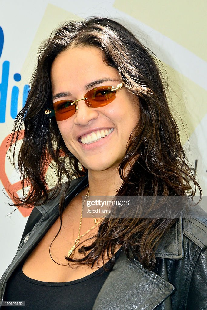 Actress Michelle Rodriguez arrives at Children Mending Hearts' 6th Annual Fundraiser 'Empathy Rocks: A Spring Into Summer Bash' on June 14, 2014 in Beverly Hills, California.