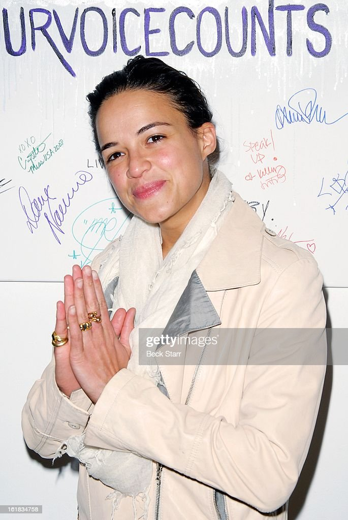Actress Michelle Rodriguez arrives at Linda's Voice live art auction at LAB ART Gallery on February 16, 2013 in Los Angeles, California.