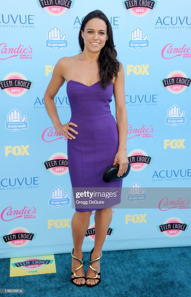 Actress Michelle Rodriguez arrives at the 2013 Teen Choice Awards at Gibson Amphitheatre on August 11, 2013 in Universal City, California.