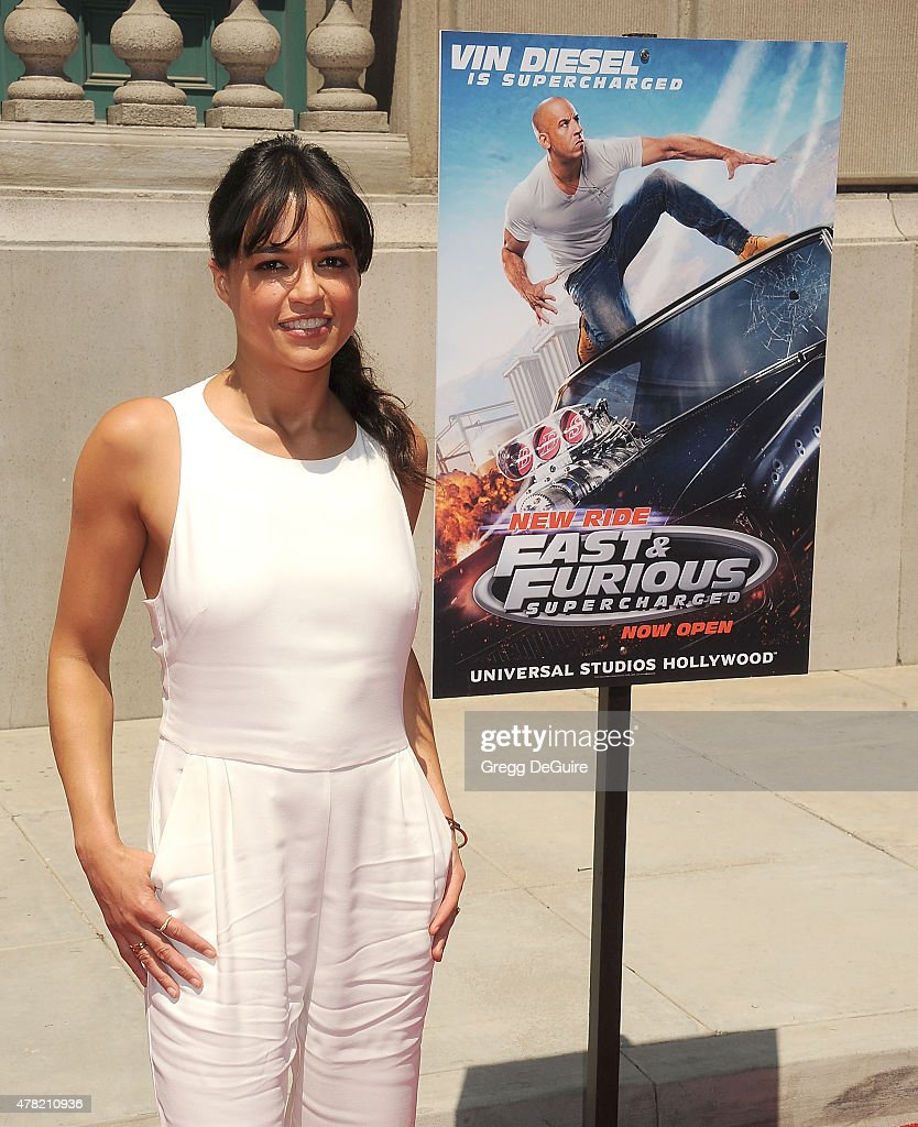 Actress Michelle Rodriguez arrives at the premiere of the 'Fast & Furious - Supercharged' Ride at Universal Studios Hollywood on June 23, 2015 in Universal City, California.