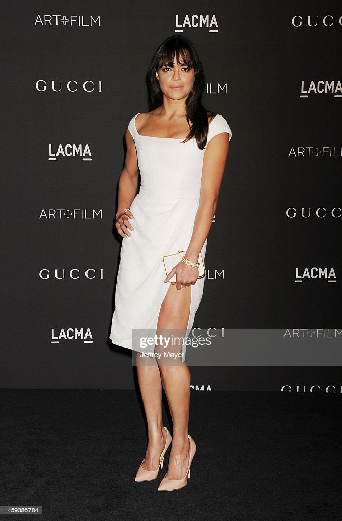 Actress Michelle Rodriguez attends the 2014 LACMA Art + Film Gala honoring Barbara Kruger and Quentin Tarantino presented by Gucci at LACMA on November 1, 2014 in Los Angeles, California.