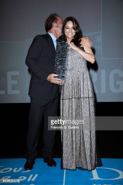 Actress Michelle Rodriguez holds the achievement tribute award she received from actor Vincent Lindon during the 43rd Deauville American Film...