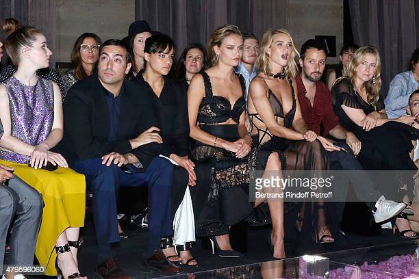 Actress Michelle Rodriguez Models Natasha Poly and Model Rosie HuntingtonWhiteley attend the Atelier Versace show as part of Paris Fashion Week Haute...