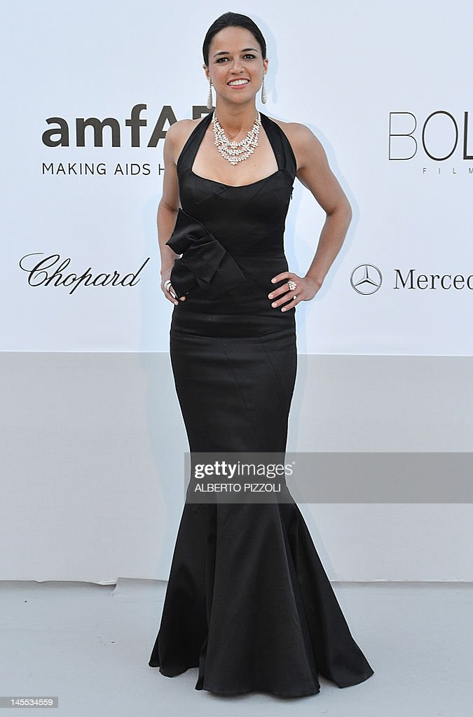 Actress Michelle Rodriguez poses as she arrives to attend the 2012 amfAR's Cinema Against Aids on May 24, 2012 in Antibes, southeastern France. AFP PHOTO / ALBERTO PIZZOLI