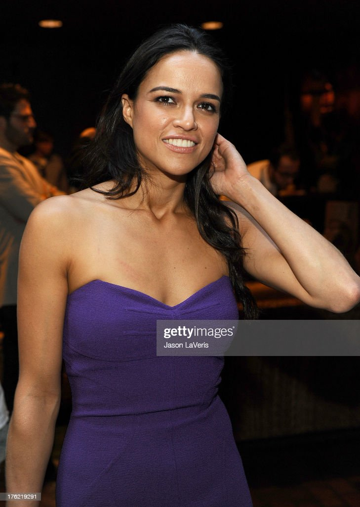 Actress Michelle Rodriguez poses in the green room at the 2013 Teen Choice Awards at Gibson Amphitheatre on August 11, 2013 in Universal City, California.