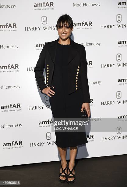 US actress Michelle Rodriguez poses prior to the Amfar dinner on the sidelines of the Paris fashion week on July 5 2015 in Paris AFP PHOTO / LOIC...