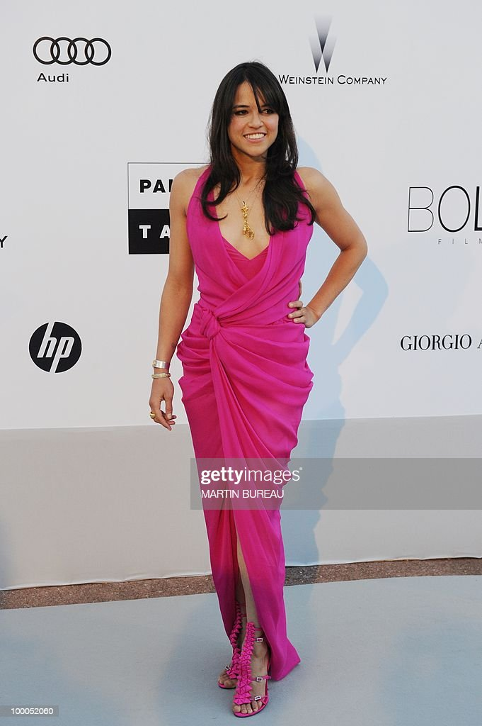 US actress Michelle Rodriguez poses while arriving to attend the 2010 amfAR's Cinema Against Aids on May 20, 2010 in Antibes, southeastern France.