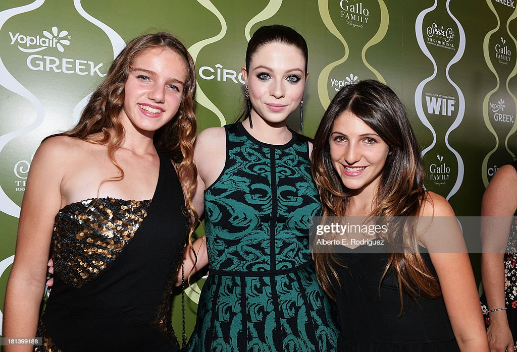 Actress <a gi-track='captionPersonalityLinkClicked' href=/galleries/search?phrase=Michelle+Trachtenberg&family=editorial&specificpeople=202081 ng-click='$event.stopPropagation()'>Michelle Trachtenberg</a> (C) and guests attend Variety & Women In Film Pre-Emmy Event presented by Yoplait Greek at Scarpetta on September 20, 2013 in Beverly Hills, California.