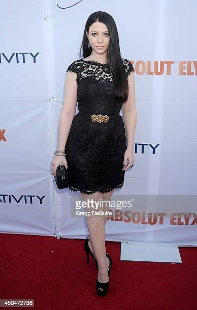 Actress Michelle Trachtenberg arrives at the Pathway To The Cures For Breast Cancer event at Barkar Hangar on June 11 2014 in Santa Monica California