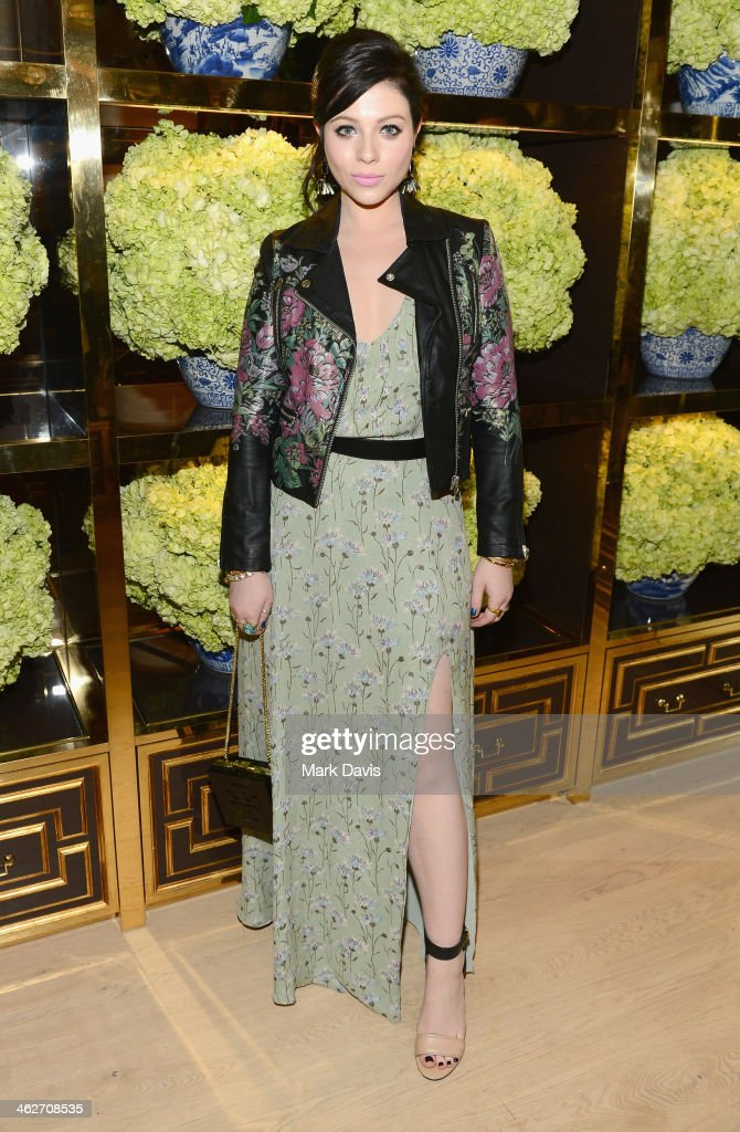 Actress <a gi-track='captionPersonalityLinkClicked' href=/galleries/search?phrase=Michelle+Trachtenberg&family=editorial&specificpeople=202081 ng-click='$event.stopPropagation()'>Michelle Trachtenberg</a> attends the Tory Burch Rodeo Drive Flagship Opening at Tory Burch on January 14, 2014 in Beverly Hills, California.