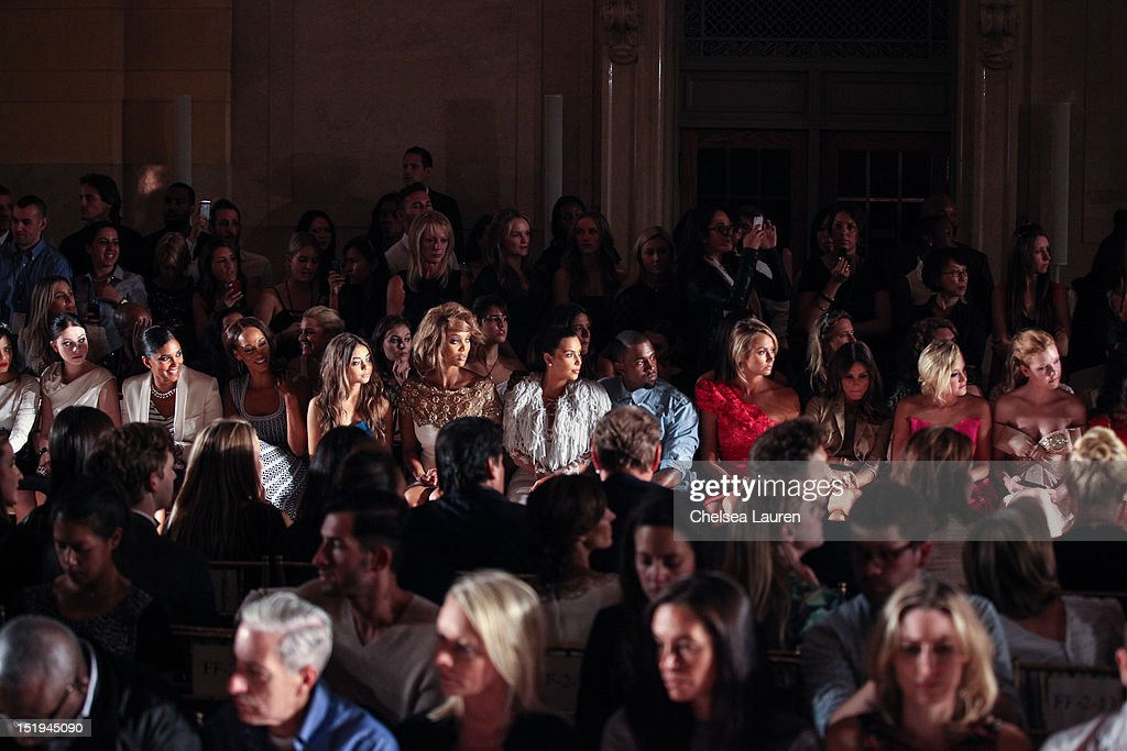 Actress Michelle Trachtenberg, designer Rachel Roy, guest, actress Sarah Hyland, model Tyra Banks, television personality Kim Kardashian, vocalist Kanye West and actress Stacy Keibler attend the Marchesa spring 2013 fashion show during Mercedes-Benz Fashion Week at Vanderbilt Hall at Grand Central Terminal on September 12, 2012 in New York City.