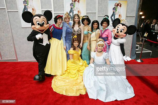 Actress Michelle Trachtenberg poses with Disney characters at the Walt Disney premiere of 'The Ice Princess' at the El Capitan Theatre on March 13...