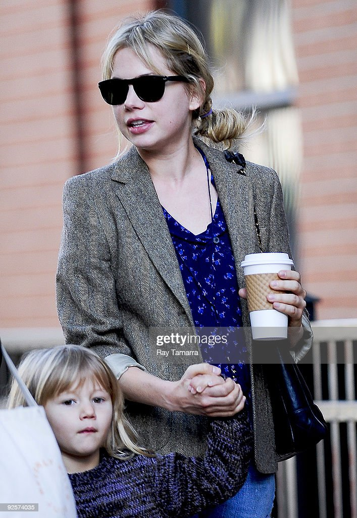 Actress Michelle Williams (R) and daughter Matilda Ledger walk to their Boerum Hill home in the borough of Brooklyn on October 30, 2009 in New York City.
