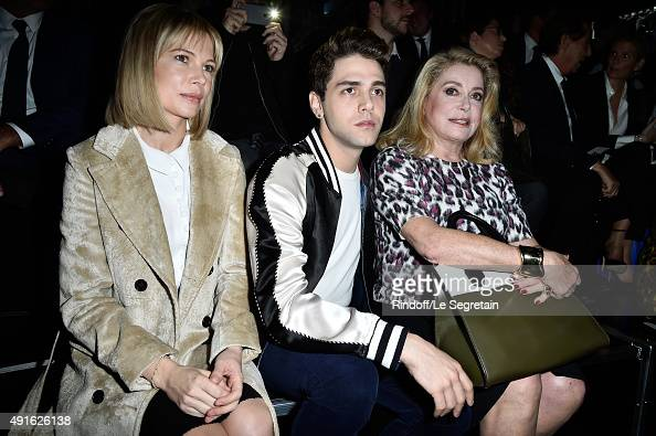 Actress Michelle Williams director Xavier Dolan and actress Catherine Deneuve attend the Louis Vuitton show as part of the Paris Fashion Week...