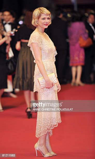 US actress Michelle Williams poses as she arrives to attend the screening of Canadian director Atom Egoyan's film 'Adoration' at the 61st Cannes...