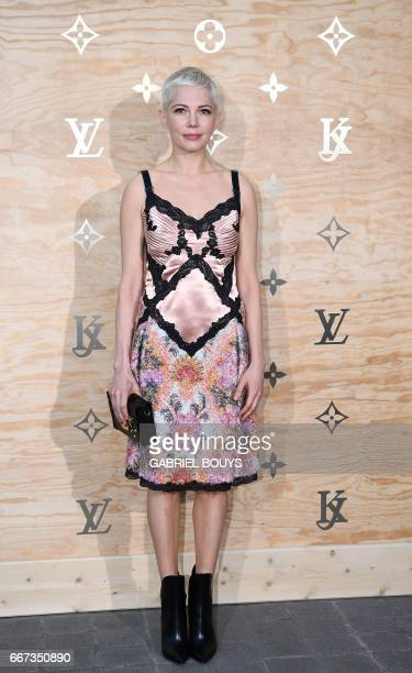 US actress Michelle Williams poses during a photocall ahead of a diner for the launch of a Louis Vuitton leather goods collection in collaboration...