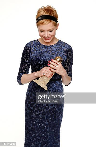 Actress Michelle Williams winner of the Best Performance by an Actress in a Motion Picture Musical or Comedy for 'My Week with Marilyn ' poses for a...