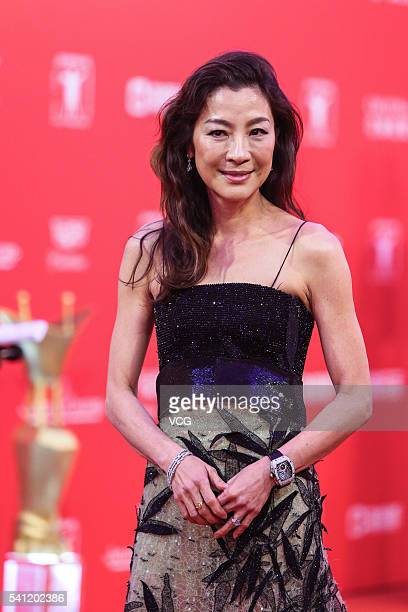 Actress Michelle Yeoh arrives at the red carpet during the closing ceremony of 19th Shanghai International Film Festival at Shanghai Grand Theatre on...