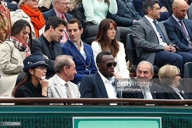 Actress Michelle Yeoh Paris mayor Bertrand Delanoe champion Usain Bolt president of FFT jean Gachassin with his wife Minou and pole vault champion...