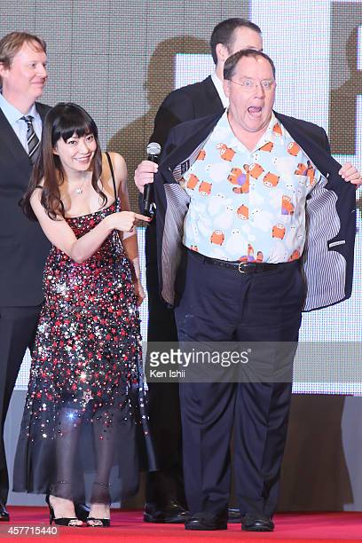 Actress Miho Kanno and executive producer John Lasetter pose for 'Big Hero 6' photocall during the opening ceremony during the 27th Tokyo...
