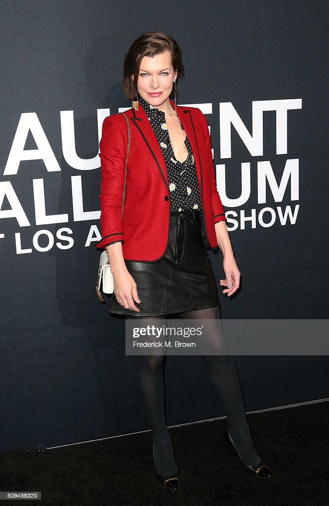 Actress Mila Jovovich arrives at the Saint Laurent show at The Hollywood Palladium on February 10 2016 in Los Angeles California