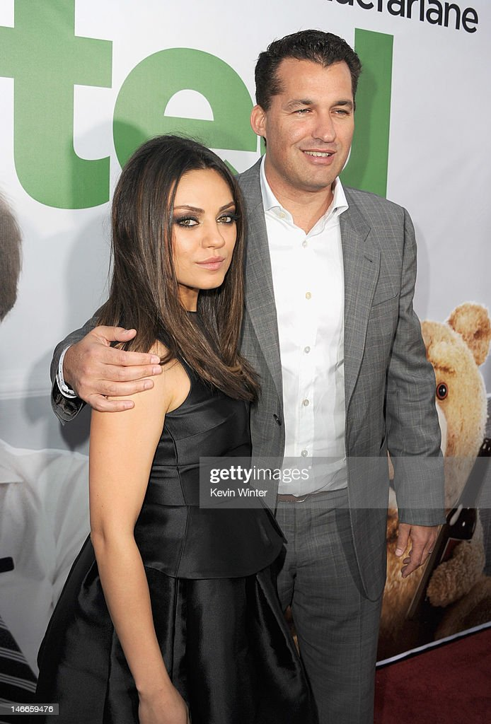 Actress Mila Kunis and producer Scott Stuber arrive at the Premiere of Universal Pictures' 'Ted' sponsored in part by AXE Hair at Grauman's Chinese...