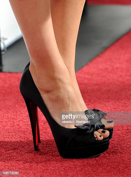 Actress Mila Kunis arrives at the 'Black Swan' closing night gala during AFI FEST 2010 presented by Audi held at Grauman's Chinese Theatre on...