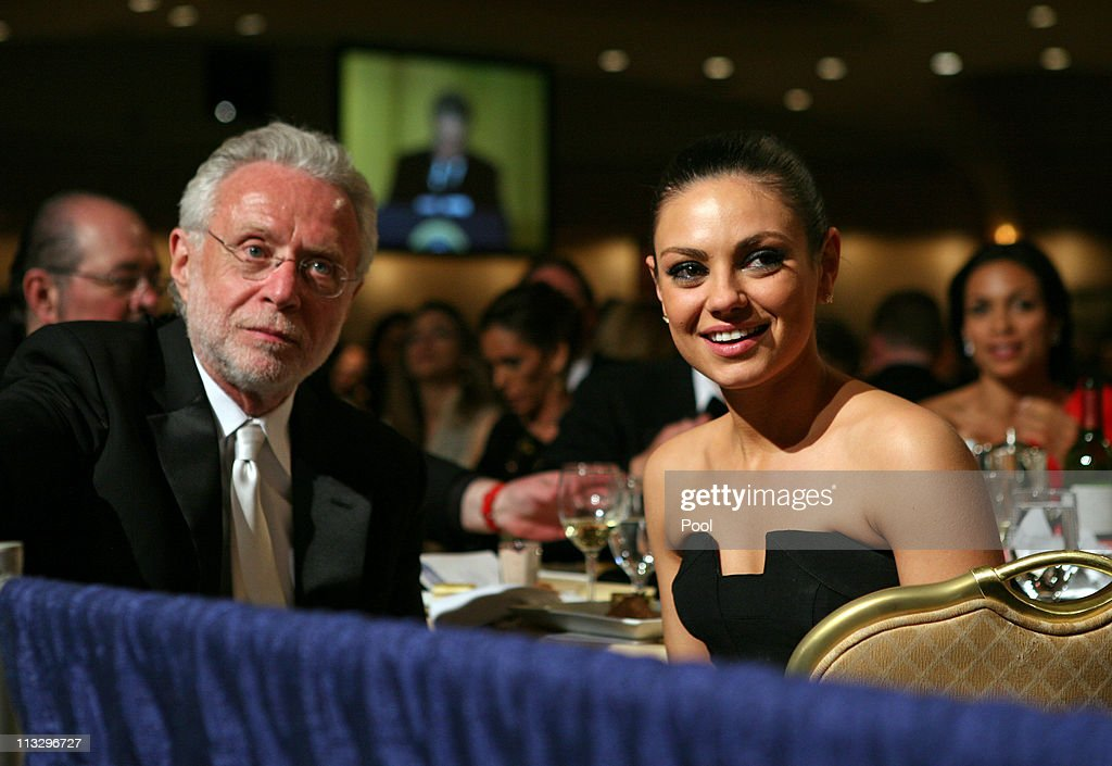 Actress <a gi-track='captionPersonalityLinkClicked' href=/galleries/search?phrase=Mila+Kunis&family=editorial&specificpeople=212845 ng-click='$event.stopPropagation()'>Mila Kunis</a> joins CNN's <a gi-track='captionPersonalityLinkClicked' href=/galleries/search?phrase=Wolf+Blitzer&family=editorial&specificpeople=221464 ng-click='$event.stopPropagation()'>Wolf Blitzer</a> at the CNN table during the annual White House Correspondent's Association Gala at the Washington Hilton hotel April 30, 2011 in Washington, DC.