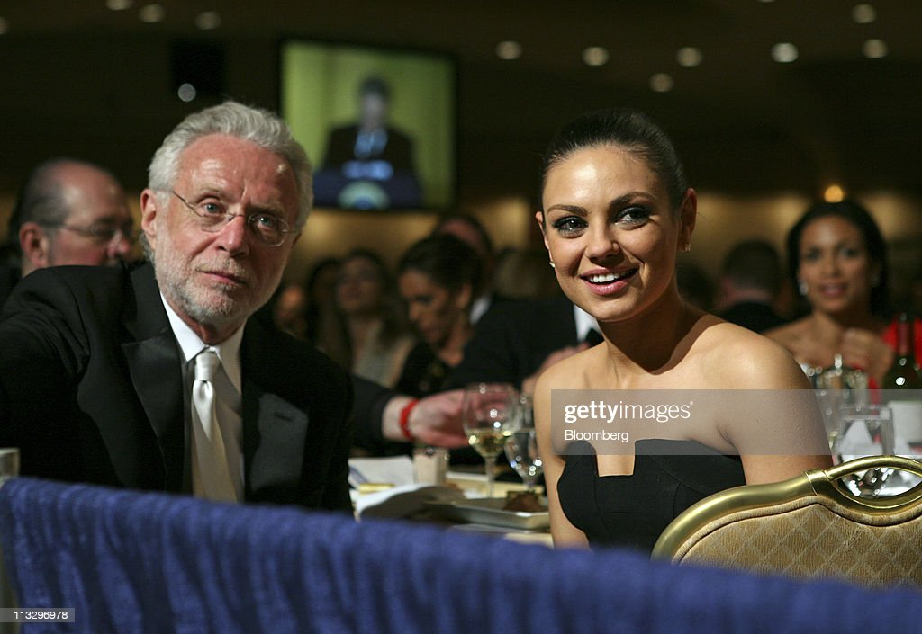 Actress <a gi-track='captionPersonalityLinkClicked' href=/galleries/search?phrase=Mila+Kunis&family=editorial&specificpeople=212845 ng-click='$event.stopPropagation()'>Mila Kunis</a> joins CNN's <a gi-track='captionPersonalityLinkClicked' href=/galleries/search?phrase=Wolf+Blitzer&family=editorial&specificpeople=221464 ng-click='$event.stopPropagation()'>Wolf Blitzer</a> at the CNN table during the annual White House Correspondents' Association (WHCA) dinner in Washington, D.C., U.S., on Saturday, April 30, 2011. The dinner raises money for WHCA scholarships and honors the recipients of the organization's journalism awards. Photographer: Martin H. Simon/Pool via Bloomberg