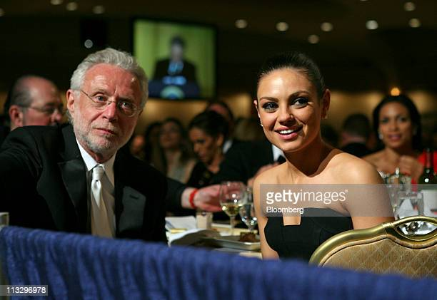 Actress Mila Kunis joins CNN's Wolf Blitzer at the CNN table during the annual White House Correspondents' Association dinner in Washington DC US on...