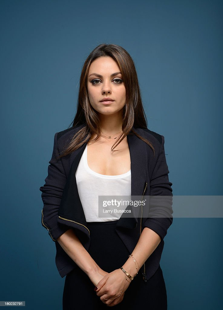 Actress <a gi-track='captionPersonalityLinkClicked' href=/galleries/search?phrase=Mila+Kunis&family=editorial&specificpeople=212845 ng-click='$event.stopPropagation()'>Mila Kunis</a> of 'Third Person' poses at the Guess Portrait Studio during 2013 Toronto International Film Festival on September 10, 2013 in Toronto, Canada.