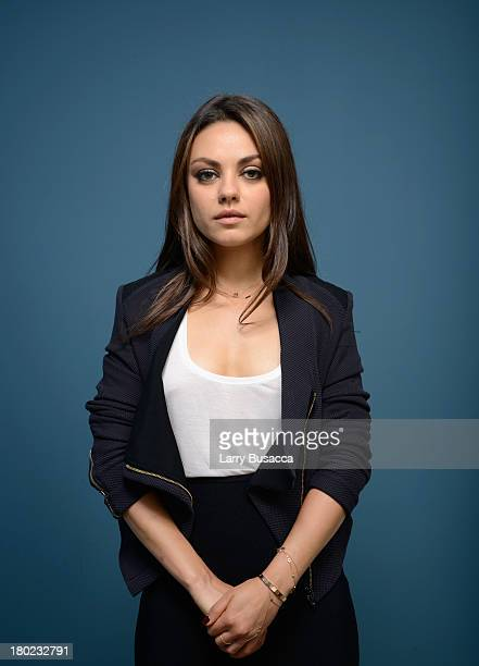 Actress Mila Kunis of 'Third Person' poses at the Guess Portrait Studio during 2013 Toronto International Film Festival on September 10 2013 in...