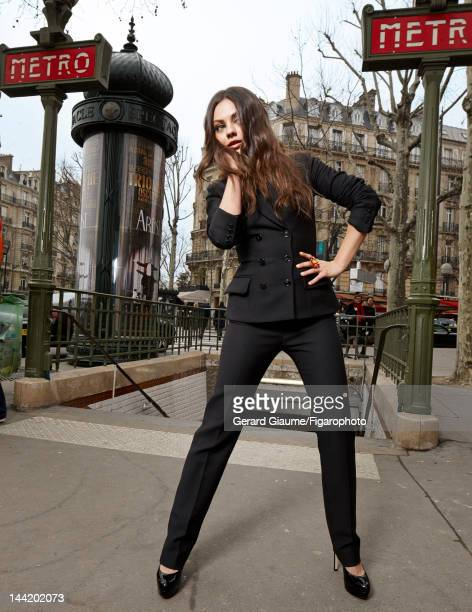 Actress Mila Kunis poses for Madame Figaro on March 1 2012 in Paris France Figaro ID 103361008 Suit ring and shoes by Dior Makeup by Dior CREDIT MUST...