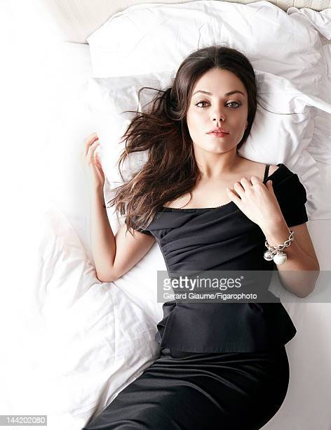 Actress Mila Kunis poses for Madame Figaro on March 1 2012 in Paris France Figaro ID 103361010 Dress and bracelet by Dior Makeup by Dior CREDIT MUST...