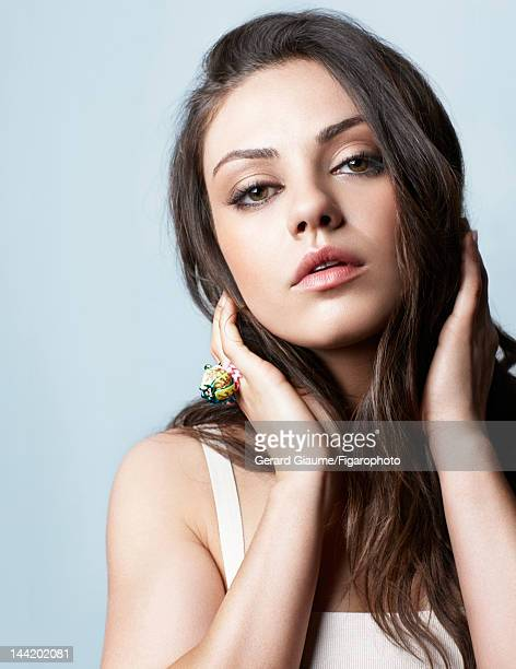 Actress Mila Kunis poses for Madame Figaro on March 1 2012 in Paris France Figaro ID 103361011 Dress and ring by Dior Makeup by Dior CREDIT MUST READ...