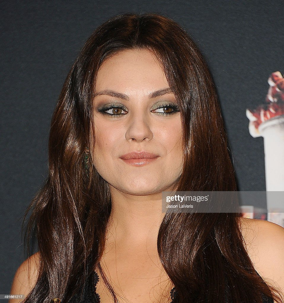 Actress Mila Kunis poses in the press room at the 2014 MTV Movie Awards at Nokia Theatre L.A. Live on April 13, 2014 in Los Angeles, California.