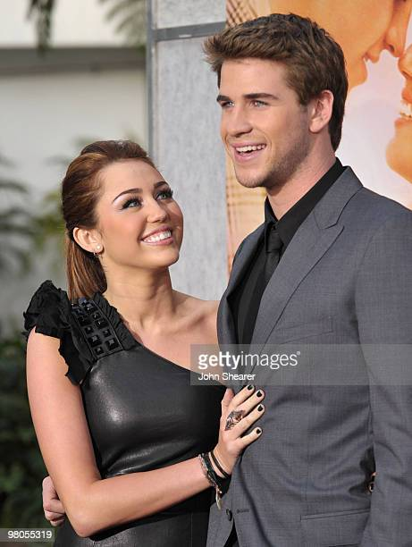 Actress Miley Cyrus and actor Liam Hemsworth arrive to 'The Last Song' Los Angeles Premiere at ArcLight Hollywood on March 25 2010 in Hollywood...