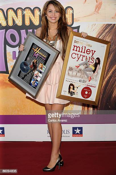 Actress Miley Cyrus attends 'Hannah MontanaThe Movie' premiere at the Kinepolis cinema on April 21 2009 in Madrid Spain