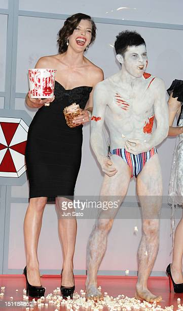 Actress Milla Jovovich and comedian Yoshio Kojima attend the 'Resident Evil Retribution' World Premiere at Roppongi Hills on September 3 2012 in...