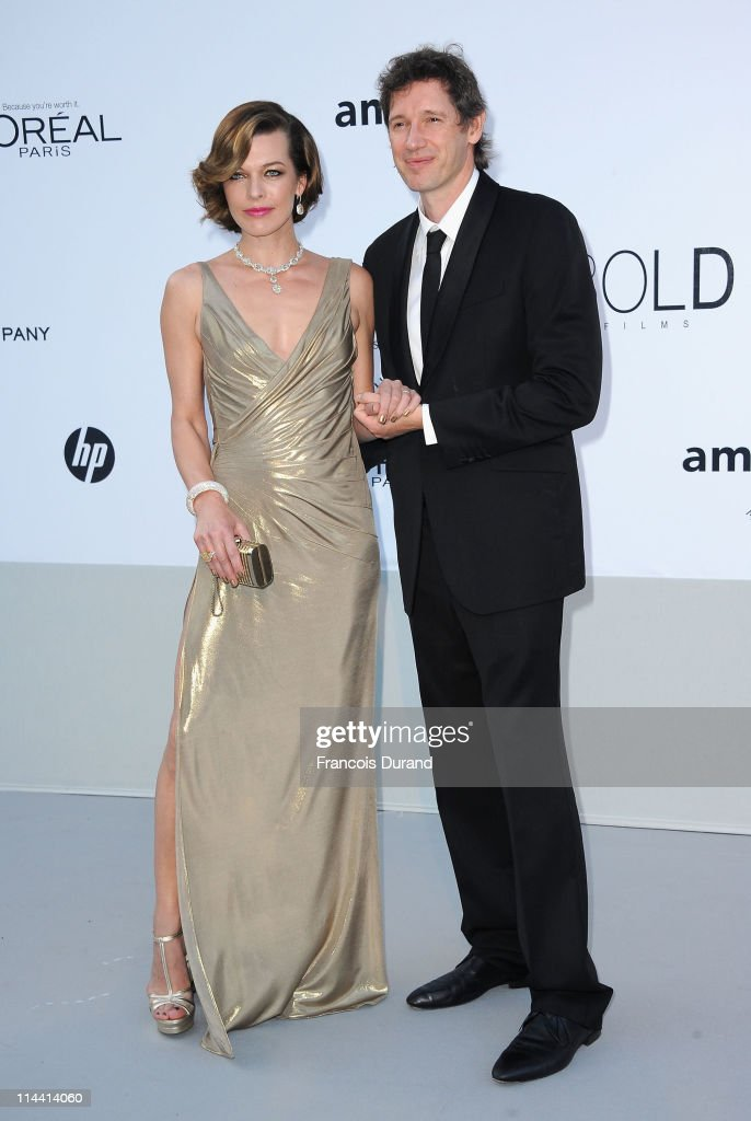 Actress Milla Jovovich and director Paul Anderson attend amfAR's Cinema Against AIDS Gala during the 64th Annual Cannes Film Festival at Hotel Du Cap on May 19, 2011 in Antibes, France.
