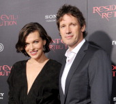 Actress Milla Jovovich and director Paul W S Anderson arrive at the Los Angeles premiere of 'Resident Evil Retribution' at Regal Cinemas LA Live on...